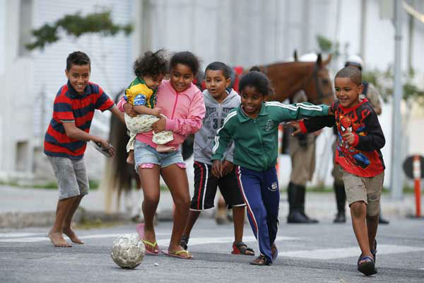 Children kick around a soccer ball outside the Independencia Stadium in Belo Horizonte, Brazil <span class=meta>AP Photo/ Victor R. Caivano</span>