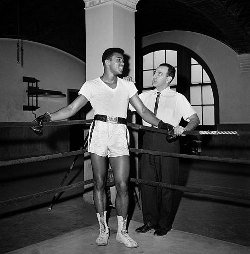<div class='meta'><div class='origin-logo' data-origin='none'></div><span class='caption-text' data-credit='ASSOCIATED PRESS'>Young heavyweight fighter Cassius Clay is seen with his trainer Angelo Dundee at City Parks Gym in New York, Feb. 8, 1962.</span></div>