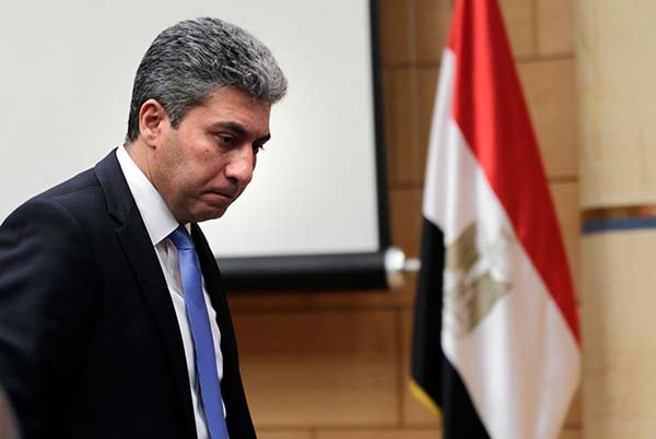 <div class='meta'><div class='origin-logo' data-origin='none'></div><span class='caption-text' data-credit='Amr Nabil/AP Photo'>Egyptian Minister of Civil Aviation Sharif Fathy leaves a press conference at the Ministry headquarters in Cairo, Egypt, Tuesday, March 29, 2016.</span></div>