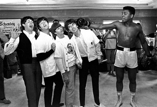 <div class='meta'><div class='origin-logo' data-origin='none'></div><span class='caption-text' data-credit='AP'>In this Feb. 18, 1964, file photo, The Beatles take a fake blow from Cassius Clay, who later changed his name to Muhammad Ali.</span></div>