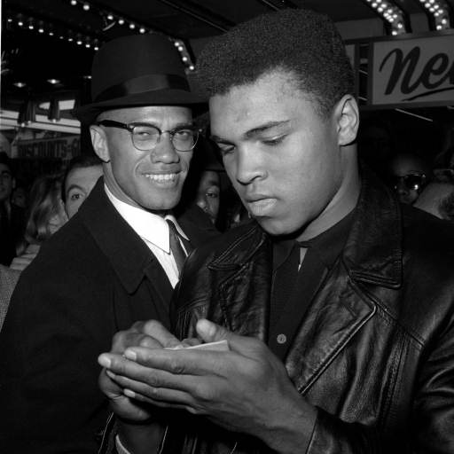 "<div class=""meta image-caption""><div class=""origin-logo origin-image none""><span>none</span></div><span class=""caption-text"">World Heavyweight Boxing Champion, Muhammad Ali, right, is shown with Black Muslim Leader, Malcolm X. (AP)</span></div>"