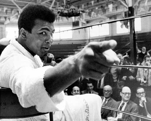 <div class='meta'><div class='origin-logo' data-origin='none'></div><span class='caption-text' data-credit='ASSOCIATED PRESS'>Heavyweight boxer Muhammad Ali makes a point during a news conference in Atlanta, Ga.</span></div>