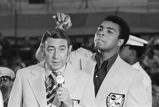 <div class='meta'><div class='origin-logo' data-origin='none'></div><span class='caption-text' data-credit='AP'>Muhammad Ali toys with the finely combed hair of television sports commentators Howard Cosell before the 1972 Olympic boxing trails.</span></div>