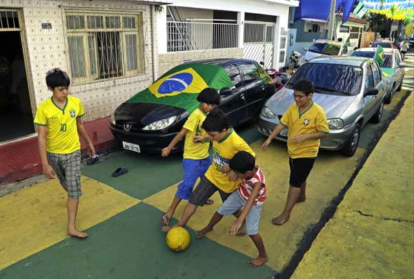 Children play soccer prior to the group G World Cup soccer match between the United States and Portugal at the Arena da Amazonia in Manaus, Brazil <span class=meta>AP Photo/ Themba Hadebe</span>