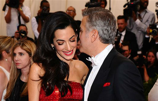 """<div class=""""meta image-caption""""><div class=""""origin-logo origin-image none""""><span>none</span></div><span class=""""caption-text"""">Amal Clooney, left, and George Clooney arrive at The Metropolitan Museum of Art's Costume Institute benefit gala. (Photo by Charles Sykes/Invision/AP) (AP Photo/ Charles Sykes)</span></div>"""
