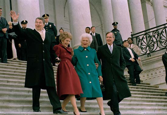 <div class='meta'><div class='origin-logo' data-origin='none'></div><span class='caption-text' data-credit='AP'>Former President Ronald Reagan, his wife Nancy Reagan, new first lady Barbara Bush and her husband President George Bush, right, walk down the Capitol steps after the inauguration</span></div>