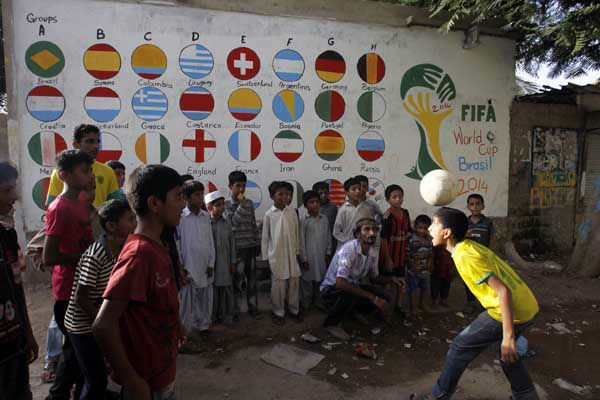 Pakistani children play soccer during celebrations for the World Cup in Karachi&#39;s slums <span class=meta>(AP Photo&#47; Fareed Khan)</span>