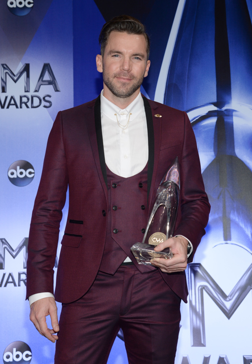 "<div class=""meta image-caption""><div class=""origin-logo origin-image none""><span>none</span></div><span class=""caption-text"">Director TK McKamy, winner of the award for music video of the year for ""Girl In A Country Song,"" poses in the press room at the 49th annual CMA Awards on Nov. 4, 2015. (Evan Agostini/Invision/AP)</span></div>"