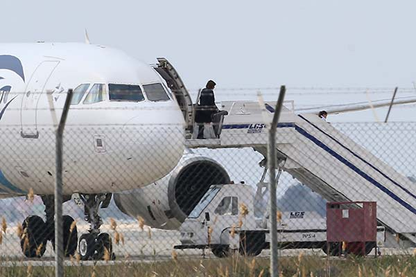 <div class='meta'><div class='origin-logo' data-origin='none'></div><span class='caption-text' data-credit='Petros Karadjias/AP Photo'>A passenger leaves a hijacked EgyptAir aircraft after landing at Larnaca Airport in Cyprus Tuesday, March 29, 2016.</span></div>