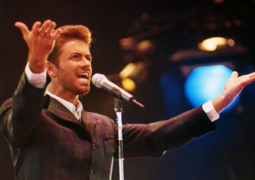 "<div class=""meta image-caption""><div class=""origin-logo origin-image ap""><span>AP</span></div><span class=""caption-text"">British singer George Michael performs in front of an audience of 11,000 people including Diana, the Princess of Wales to mark World AIDS Day on December 2, 1993. (AP Photo/Gill Allen)</span></div>"