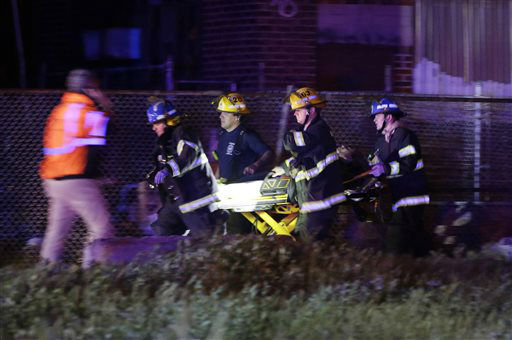 <div class='meta'><div class='origin-logo' data-origin='none'></div><span class='caption-text' data-credit='AP Photo/ Matt Slocum'>Emergency personnel transport a victim at the scene of a train wreck, Tuesday, May 12, 2015, in Philadelphia.</span></div>