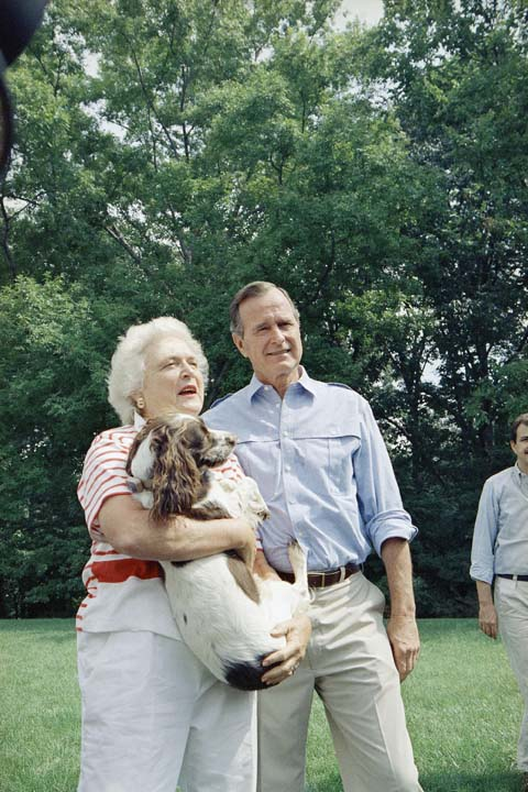 <div class='meta'><div class='origin-logo' data-origin='none'></div><span class='caption-text' data-credit='AP'>Vice President George H.W. Bush, right, and his Barbara Bush, holding the family dog, talk to reporters after a press conference outside their home, Sept. 3, 1988, Washington, D.C.</span></div>