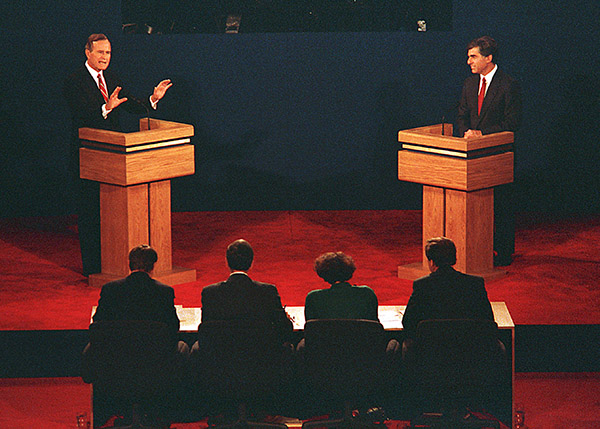 <div class='meta'><div class='origin-logo' data-origin='AP'></div><span class='caption-text' data-credit='Dennis Cook/AP'>U.S. Vice President George Bush, left, and Mass. Gov. Michael Dukakis are shown during their first presidential debate at Wake Forest University, Sept. 25, 1988.</span></div>
