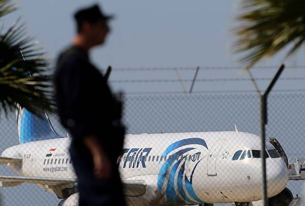 <div class='meta'><div class='origin-logo' data-origin='none'></div><span class='caption-text' data-credit='Petros Karadjias/AP Photo'>A police officer stands guard by the fence of the airport as a hijacked EgyptAir aircraft is seen after landing at Larnaca Airport in Cyprus Tuesday, March 29, 2016.</span></div>