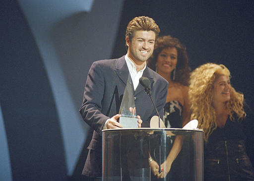 "<div class=""meta image-caption""><div class=""origin-logo origin-image ap""><span>AP</span></div><span class=""caption-text"">Crossover singer George Michael breaks out in a big smile as he accepts one of his three American Music Awards during ceremonies Monday night, Jan. 31, 1989. (AP Photo/Alan Greth)</span></div>"