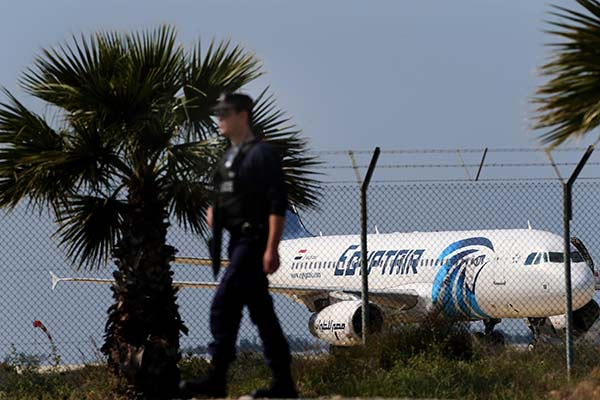 <div class='meta'><div class='origin-logo' data-origin='none'></div><span class='caption-text' data-credit='Petros Karadjias/AP Photo'>A police officer patrols outside the airport as a hijacked aircraft of EgyptAir is seen after landing at Larnaca Airport in Cyprus Tuesday, March 29, 2016.</span></div>