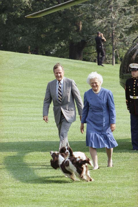 <div class='meta'><div class='origin-logo' data-origin='none'></div><span class='caption-text' data-credit='ASSOCIATED PRESS'>Pres. George H. W. Bush and First Lady Barbara Bush return to the White House from Camp David and are met by the family dogs, Sunday, Sept. 16, 1990, Washington, D.C.</span></div>