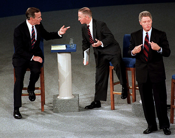 <div class='meta'><div class='origin-logo' data-origin='AP'></div><span class='caption-text' data-credit='Marcy Nighswander/AP'>President George H. W. Bush talks with Ross Perot as Democratic candidate Bill Clinton stands aside at the end of their second presidential debate in Richmond, VA.</span></div>