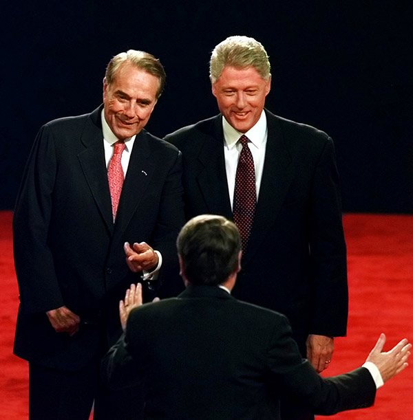 <div class='meta'><div class='origin-logo' data-origin='AP'></div><span class='caption-text' data-credit='Charles Krupa/AP'>President Clinton and Bob Dole greet moderator Jim Lehrer after the conclusion of the presidential debate at the Bushnell Theater in Hartford, Conn., Sunday Oct. 6, 1996.</span></div>