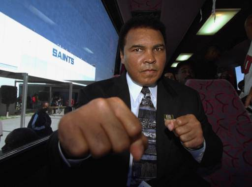 <div class='meta'><div class='origin-logo' data-origin='none'></div><span class='caption-text' data-credit='AP'>Muhammad Ali playfully spars with a photographer while on a tour bus to visit Alain Leroy Locke High School, Tuesday, December 3, 1996, in South-Central Los Angeles.</span></div>