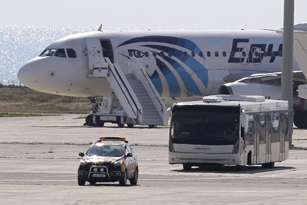 <div class='meta'><div class='origin-logo' data-origin='none'></div><span class='caption-text' data-credit='Petros Karadjias/AP Photo'>A bus carries passengers from the hijacked EgyptAir aircraft after it landed at Larnaca airport Tuesday, March 29, 2016.</span></div>