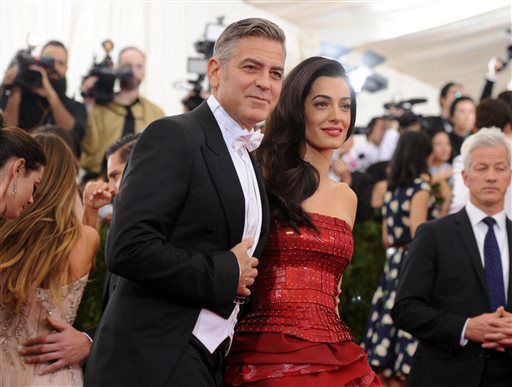 """<div class=""""meta image-caption""""><div class=""""origin-logo origin-image none""""><span>none</span></div><span class=""""caption-text"""">George Clooney and Amal Clooney arrive at The Metropolitan Museum of Art's Costume Institute benefit gala. (Photo by Evan Agostini/Invision/AP) (AP Photo/ Evan Agostini)</span></div>"""