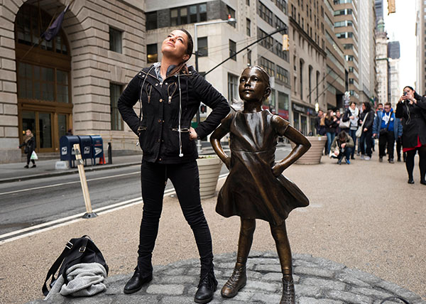 "<div class=""meta image-caption""><div class=""origin-logo origin-image wtvd""><span>wtvd</span></div><span class=""caption-text"">A woman strikes a pose in front of a statue titled ""Fearless Girl"" in New York. (Mark Lennihan/AP)</span></div>"