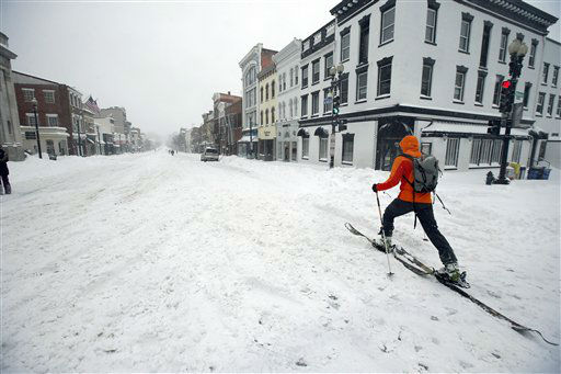 <div class='meta'><div class='origin-logo' data-origin='none'></div><span class='caption-text' data-credit='AP Photo/ Alex Brandon'>A man uses cross country skies as he goes down M Street NW in the snow, Saturday, Jan. 23, 2016 in the Georgetown area of Washington.</span></div>