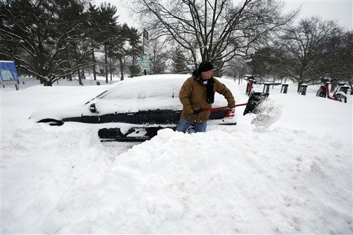 <div class='meta'><div class='origin-logo' data-origin='none'></div><span class='caption-text' data-credit='AP Photo/ Alex Brandon'>Jared Meyer of Chattanooga, Tenn., digs out his car from the snow, Saturday, Jan. 23, 2016 in Arlington, Va.</span></div>