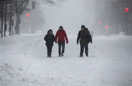 <div class='meta'><div class='origin-logo' data-origin='none'></div><span class='caption-text' data-credit='AP Photo/ Jon Elswick'>People walk on snow-covered streets in downtown Washington on Saturday, Jan. 23, 2016.</span></div>
