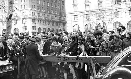 "<div class=""meta image-caption""><div class=""origin-logo origin-image none""><span>none</span></div><span class=""caption-text"">Police enforce the barricades outside New York's Plaza Hotel as fans push forward in hopes of a view of The Beatles after their arrival for an American tour in 1964.  (AP Photo)</span></div>"