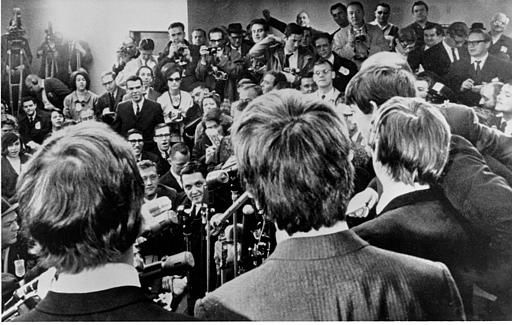 The Beatles face the media on arrival at JFK airport on Feb. 7, 1964. They were also greeted by a screaming crowd estimated at 5,000. <span class=meta>AP Photo</span>