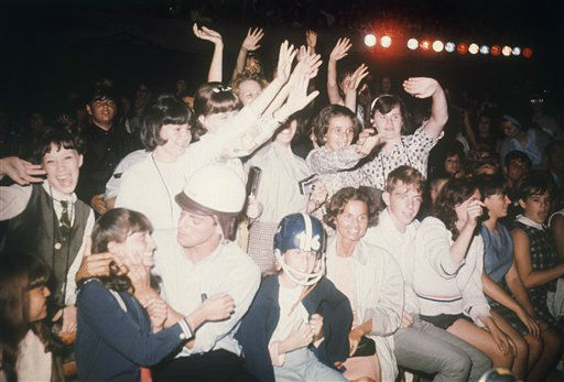 "<div class=""meta image-caption""><div class=""origin-logo origin-image none""><span>none</span></div><span class=""caption-text"">American fans in New York react during the Beatles' concert on the ""Ed Sullivan Show,"" Feb. 8, 1964. (AP Photo)</span></div>"