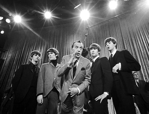 Ed Sullivan, center, stands with The Beatles during a rehearsal for the British group's first American appearance, on Feb. 8, 1964. <span class=meta>AP Photo/</span>