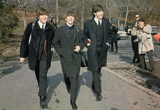 Three of the four Beatles, from left, John Lennon, Ringo Starr, and Paul McCartney, walk in Central Park in New York City, Feb. 10, 1964 on their first U.S. tour. <span class=meta>AP Photo</span>