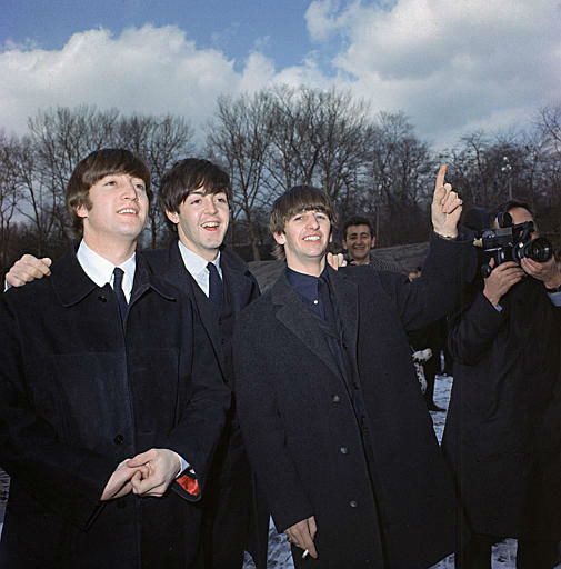 Three of the four Beatles, John Lennon, left, Paul McCartney, center, and Ringo Starr, are shown in Central Park, Feb. 10, 1964, on their first U.S. tour. <span class=meta>AP Photo</span>