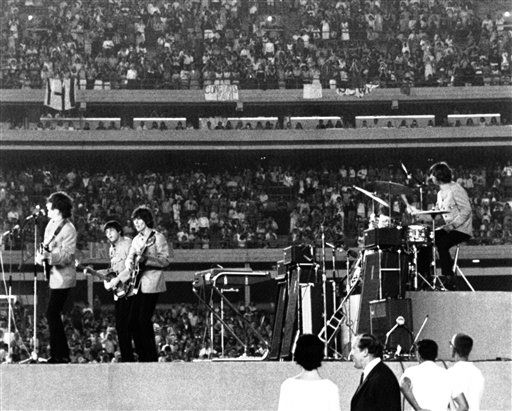 "<div class=""meta image-caption""><div class=""origin-logo origin-image none""><span>none</span></div><span class=""caption-text"">The Beatles performing at New York's Shea Stadium on Sunday, August 15, 1965, as more than 50,000 fans cheer them on. (AP Photo)</span></div>"