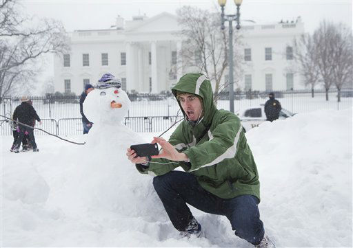 <div class='meta'><div class='origin-logo' data-origin='none'></div><span class='caption-text' data-credit='AP Photo/ Manuel Balce Ceneta'>Harrison Feind of Boulder, Colo., takes a selfie with a snowman in front of the White House in Washington, Saturday, Jan. 23, 2016.</span></div>