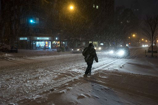 <div class='meta'><div class='origin-logo' data-origin='none'></div><span class='caption-text' data-credit='AP Photo/ Craig Ruttle'>Heavy snow falls in New York's Upper West Side, Saturday, Jan. 23, 2016, as a large winter storm rolls up the East Coast.</span></div>