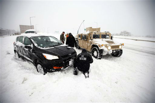 <div class='meta'><div class='origin-logo' data-origin='none'></div><span class='caption-text' data-credit='AP Photo/ Alex Brandon'>Soldiers with the 275th Military Police company, and a Washington Firefighter, in a Humvee, assist a stranded motorist in the snow on I-395, Saturday, Jan. 23, 2016 in Washington.</span></div>