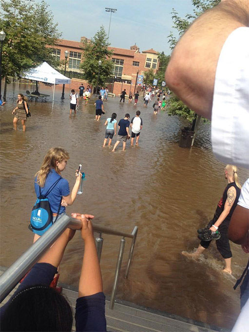 Students, unaware of the danger, snap photos of the encroaching water. <span class=meta>(Bridgeyyy__ &#47; Twitter)</span>