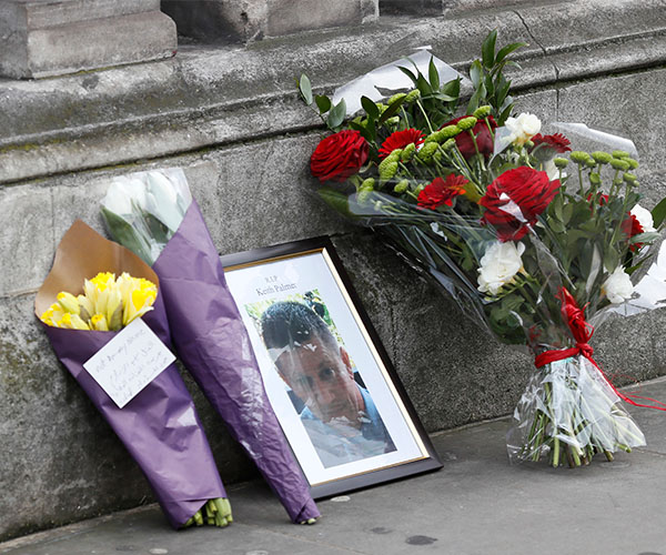 "<div class=""meta image-caption""><div class=""origin-logo origin-image kabc""><span>kabc</span></div><span class=""caption-text"">Flowers and a photo of killed police officer Keith Palmer on Whitehall near the Houses of Parliament in London, Thursday March 23, 2017. (Kirsty Wigglesworth/AP)</span></div>"