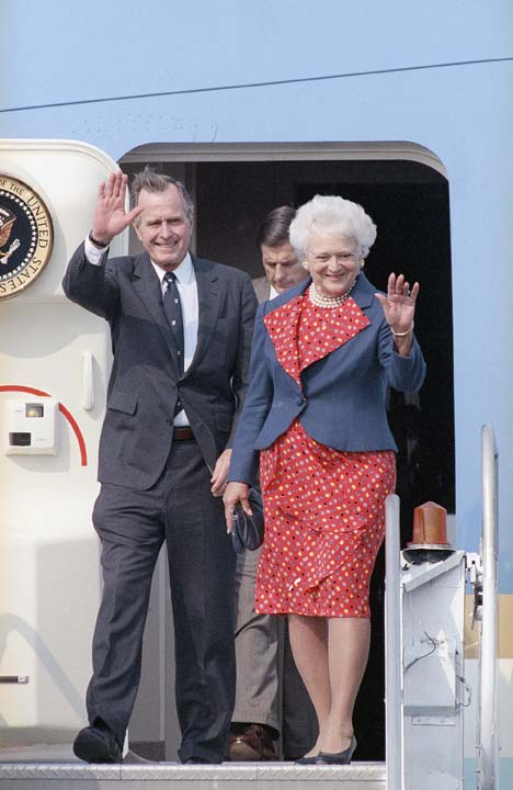 <div class='meta'><div class='origin-logo' data-origin='none'></div><span class='caption-text' data-credit='ASSOCIATED PRESS'>Pres. George H. W. Bush, left, and First Lady Barbara Bush wave as they arrive at Newark International Airport on their way to New York, Saturday, Sept. 29, 1990, Newark, N.J.</span></div>