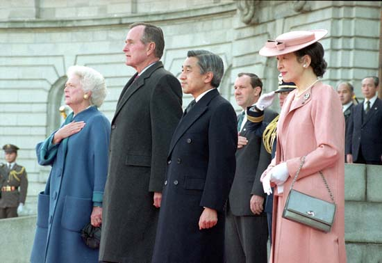 <div class='meta'><div class='origin-logo' data-origin='none'></div><span class='caption-text' data-credit='ASSOCIATED PRESS'>U.S. President George Bush and first lady Barbara Bush stand at attention together with Japan's Emperor Akihito and Empress Michiko during a ceremony in Tokyo, Jan. 8, 1992.</span></div>