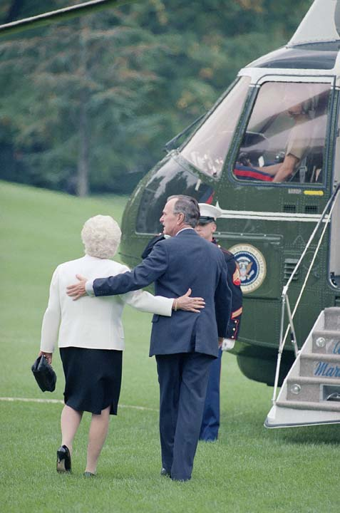 <div class='meta'><div class='origin-logo' data-origin='none'></div><span class='caption-text' data-credit='ASSOCIATED PRESS'>President  George H.W. Bush and Mrs. Barbara Bush walk arm in arm towards Marine one on the lawn of the White House, Washington on Sunday, Oct. 11, 1992.</span></div>