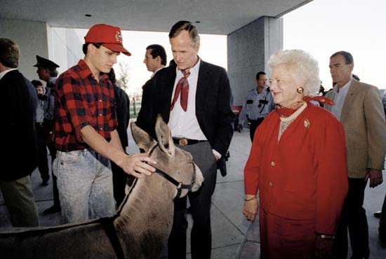 <div class='meta'><div class='origin-logo' data-origin='none'></div><span class='caption-text' data-credit='AP'>The Bushes made an impromptu stop at the Houston Rodeo to shake hands with people attending the event. (AP Photo/Doug Mills)</span></div>