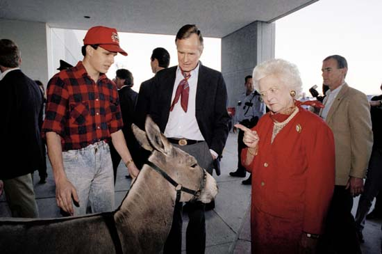 <div class='meta'><div class='origin-logo' data-origin='none'></div><span class='caption-text' data-credit='AP'>First lady Barbara Bush wags a finger at a donkey as President George H.W. Bush looks on at the Houston Livestock Show and Rodeo, Feb. 28, 1992 in Houston.</span></div>