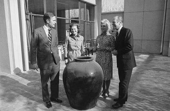 <div class='meta'><div class='origin-logo' data-origin='none'></div><span class='caption-text' data-credit='AP'>President Gerald Ford and first lady Betty Ford visit with George Bush, chief of the United States Liaison office, and his wife Barbara at the U.S. Liaison in Peking, China, Dec. 4</span></div>