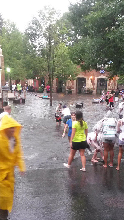One man wouldn&#39;t let the rain keep him from having fun.. &#40;in the blue shirt in the way back&#41;. <span class=meta>(Cudsta101 &#47; Reddit)</span>