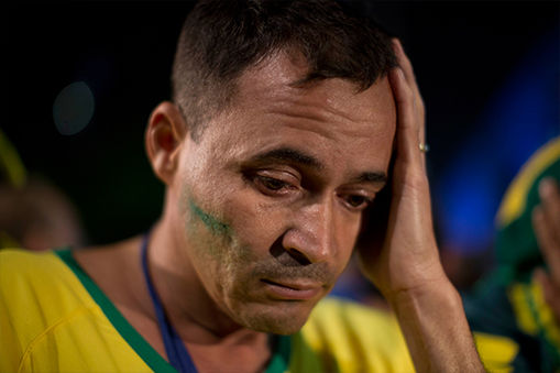 One Brazil fan is distraught after the loss. <span class=meta>AP/Dario Lopez-Mills</span>